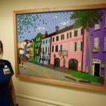 Beth Beaty RN with artwork